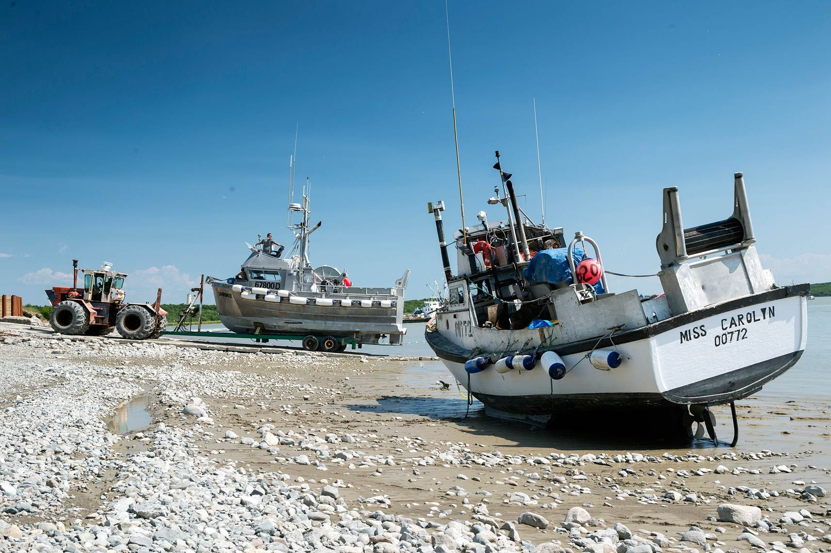 The fishing vessel Shrike gets launched into the Naknek River at the Lummi Fisheries launch ramp, while the F/V Miss Carolyn waits for the tide to come back in. The combination of shallow waters and very large tides makes for interesting logistics in Bristol Bay.