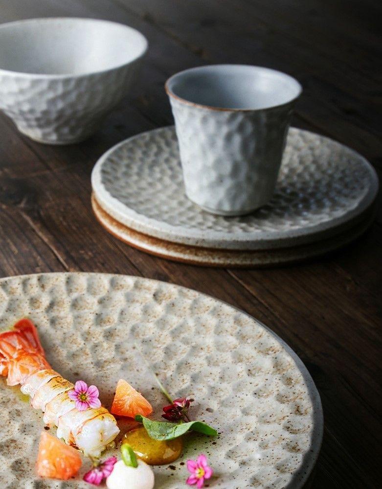Handmade ceramic dining set.  Full of texture and artistic.