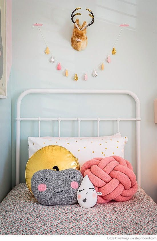 Love these fun pillows, the antlers, and that cute vintage bed!