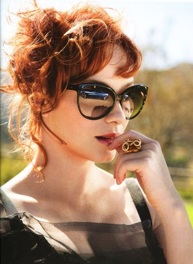 "Christina Hendricks from ""Mad Men"" rocking the cat-eye style with big black frames and mirrored lenses. HOT!"