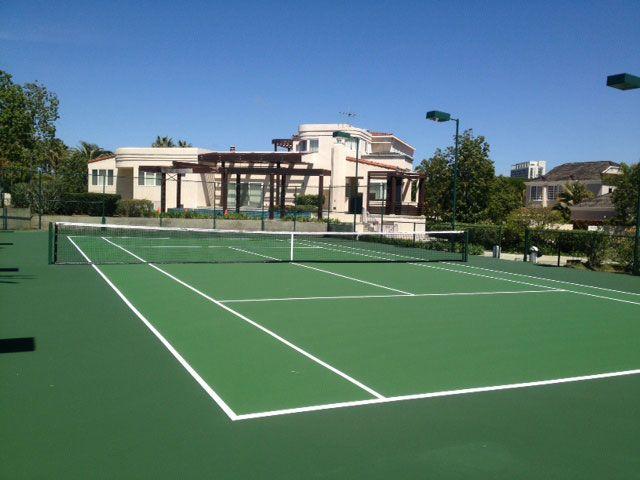 Green on green tennis court.