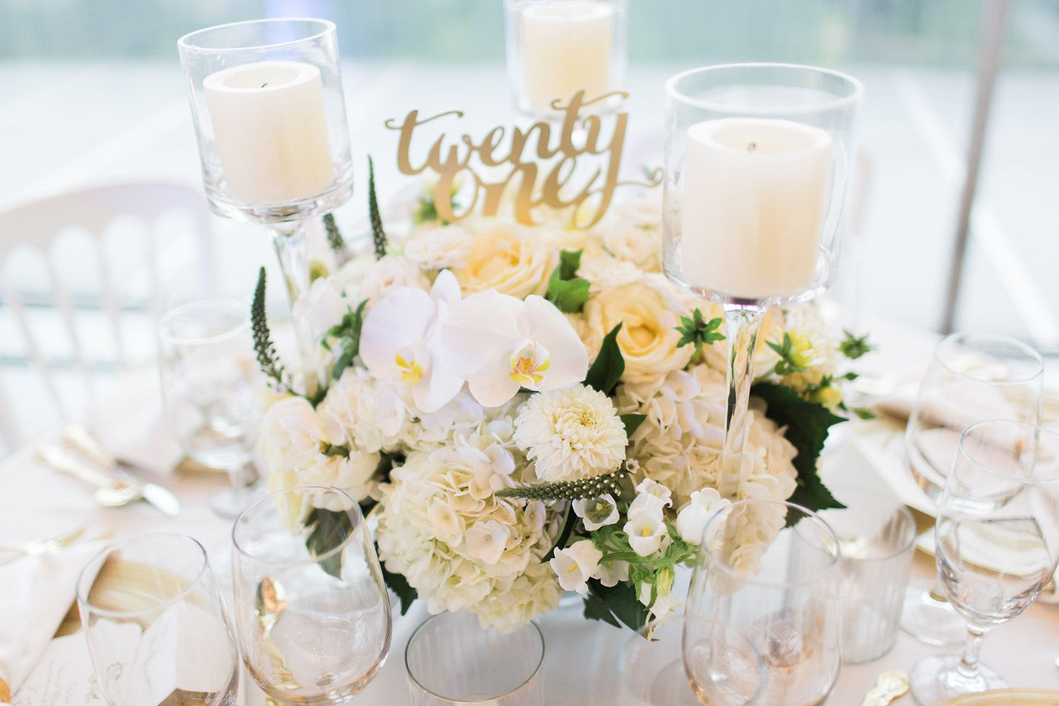 Luxe all white wedding floral details. Guest centerpieces with white ...