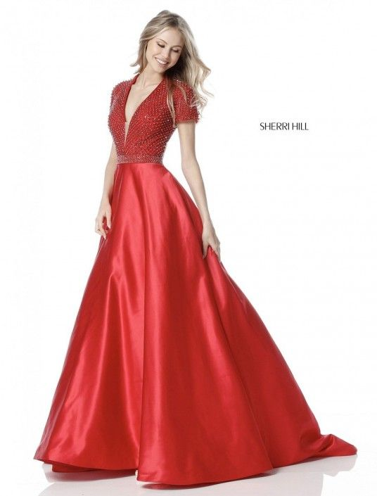 Style 51819 from Sherri Hill is a short sleeve evening gown with a deep V  neck