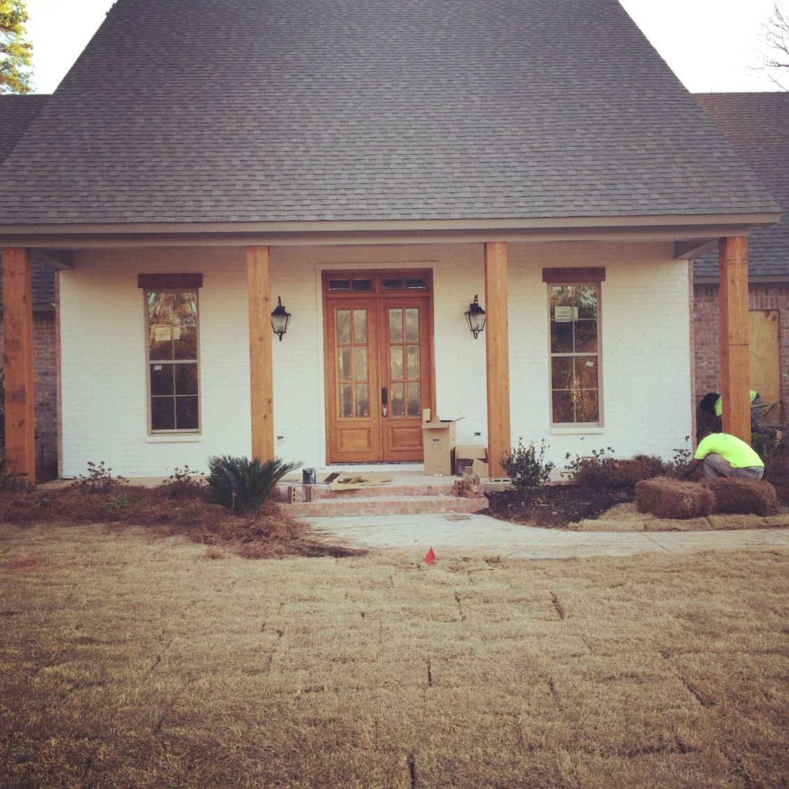 acadian farmhouse front porch sherwin williams swiss coffee on