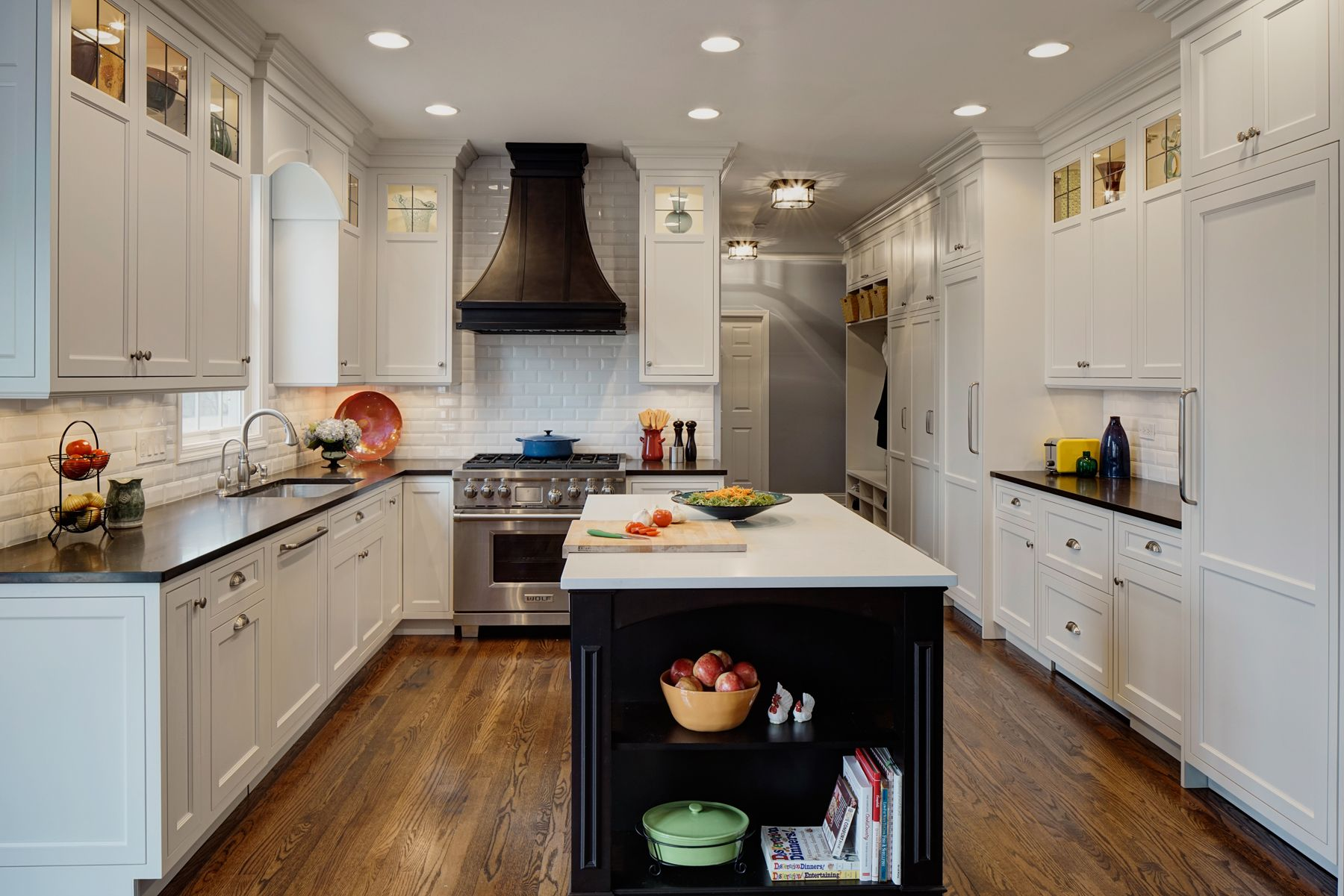 By installing recessed can lights uniformly throughout the space instead of decorative pendants above the island, the kitchen appears more open and spacious. From drurydesigns.com