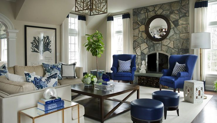 blue chair living room tall plants morgan harrison home rooms wingback chairs fireplace seating floor to ceiling stone