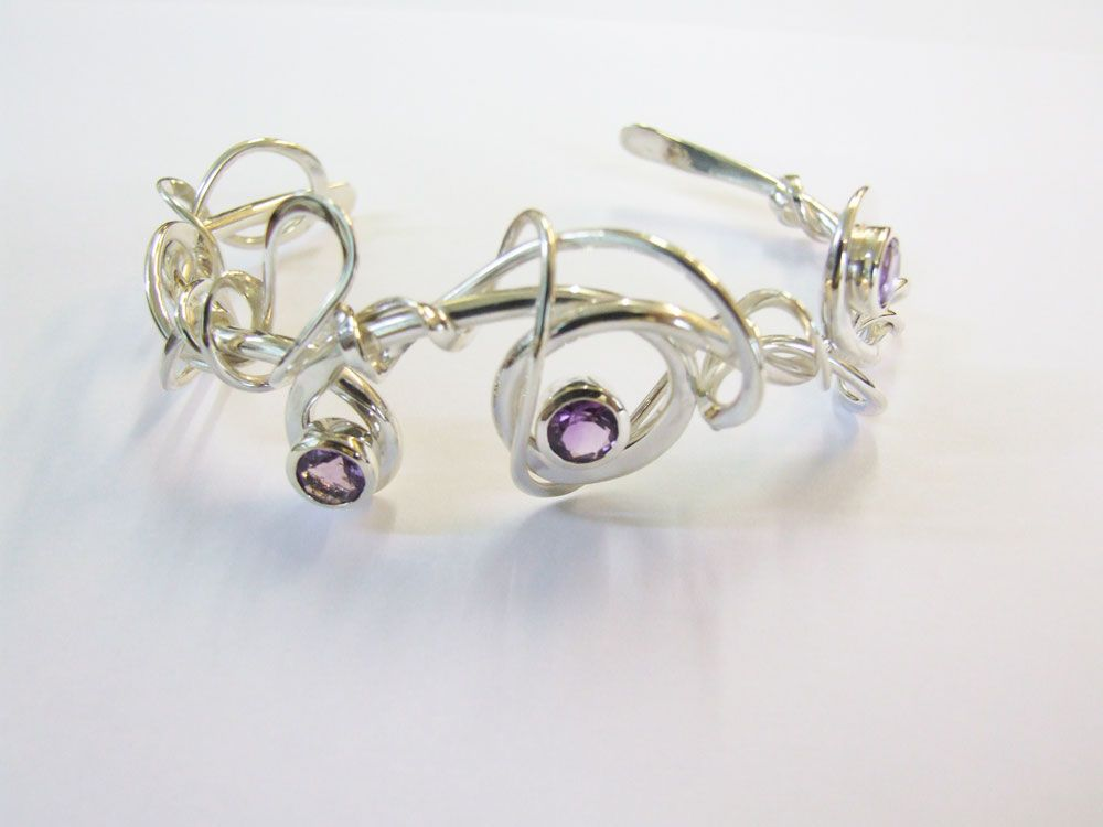 Beautifully twisted silver is set with bright coloured amethyst. Desinged and Handmade by Cathy Stephens
