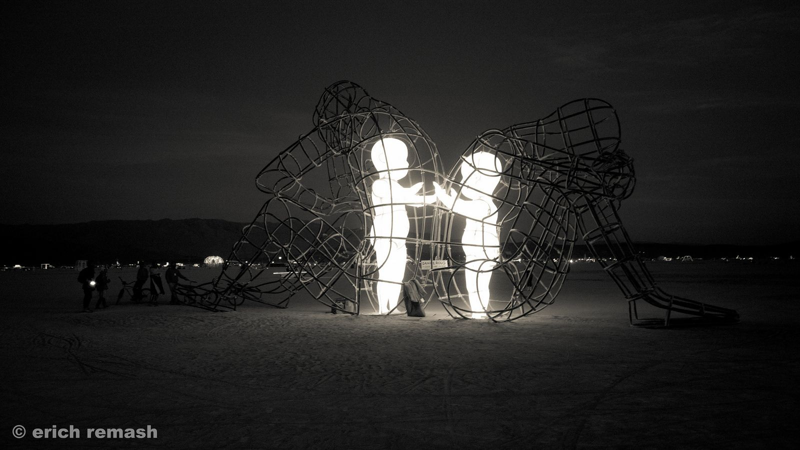Love Human Nature Burning Man And Symbols - Thought provoking burning man sculpture shows inner children trapped inside adult bodies