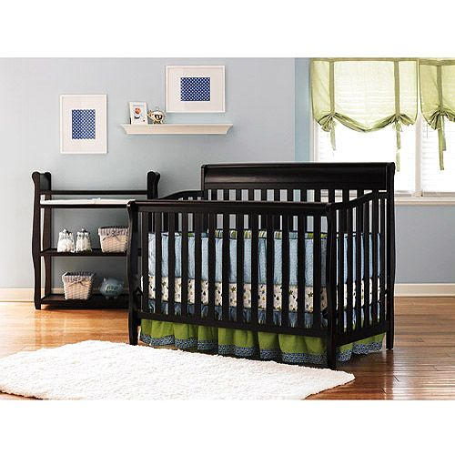 crib that turns into a twin bed, love the dark wood ...