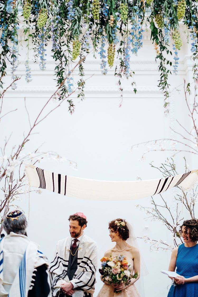 A Cute And Quirky Springtime Jewish Wedding With A Blush Watters Gown At Royal Horticultural Halls London Uk Smashing The Glass Jewish Wedding Blog Jewish Wedding Wedding Chuppah