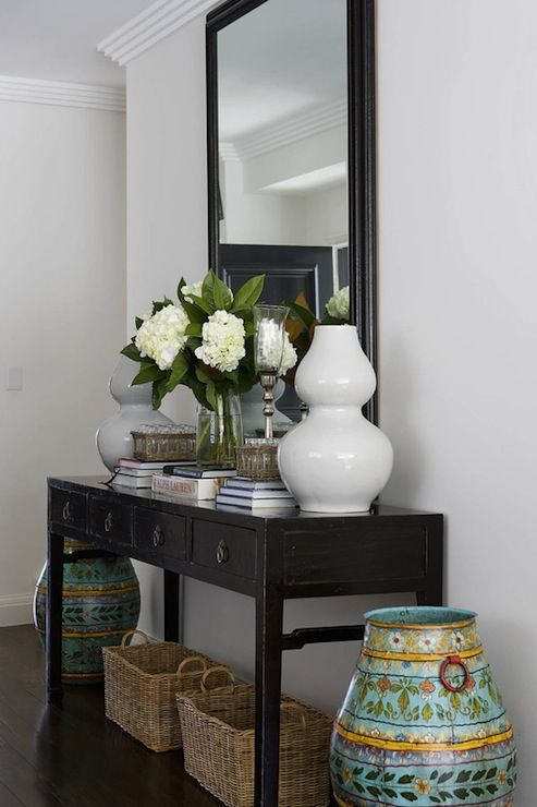 Entry Way Simple And Classic Black Foyer Designed By Denai Kulcsar Interiors Hallway Table Decor Console Table Decorating Entry Table Decor