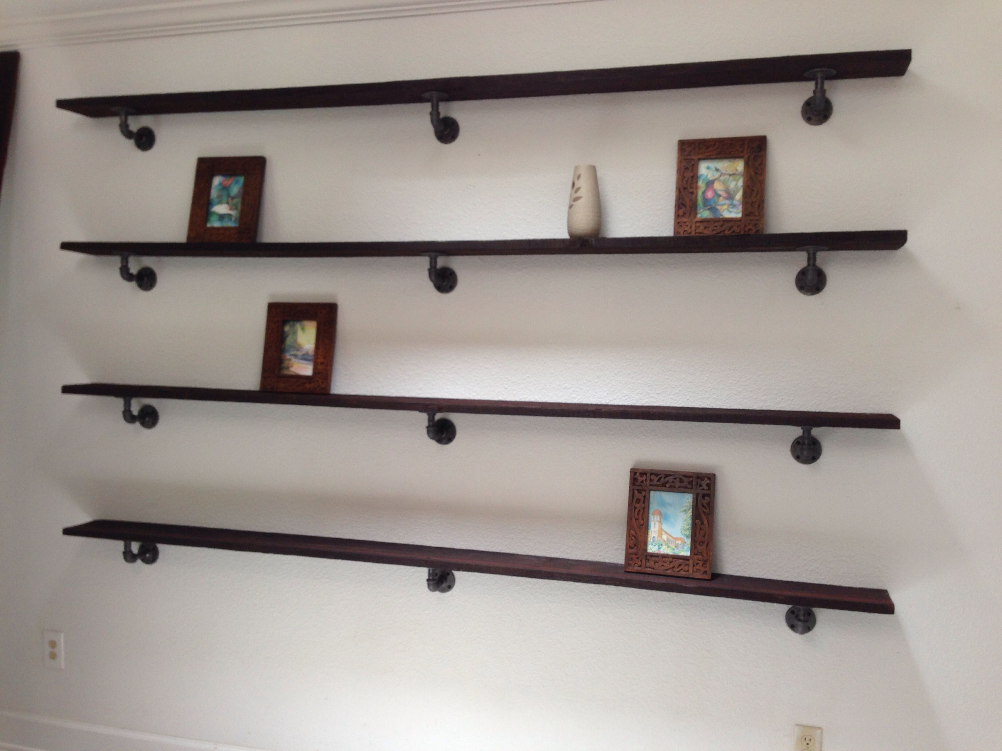 Custom barn wood shelves with urban rustic plumbing pipe I think