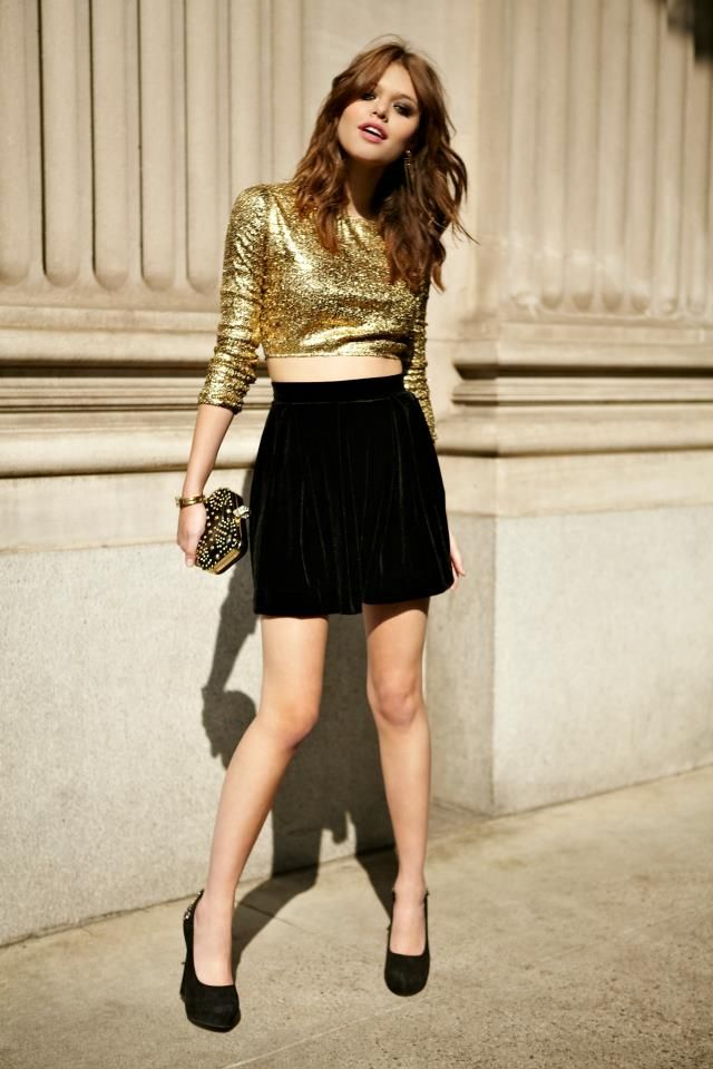 459371ebef Gold Sequin Cropped Jumper from Nasty Gal. Paired with a black velvet  skater skirt this is a glamorous winter party outfit idea.