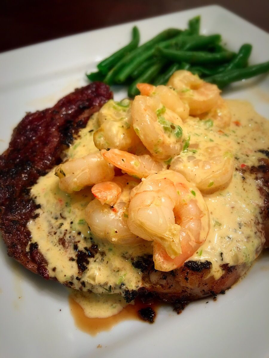 Surf And Turf Ribeye With A Creamy Shrimp Topping