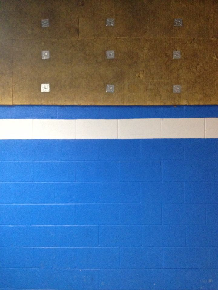 I was drawn to this because of the bright blue wall complemented with the white stripe and how the light throws a gradient from left to right. -P. Francis