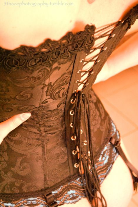7801dd4ede1 Corset. I need to be wearing one each day to hold in my ever expanding  torso. Oh
