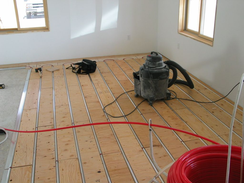 Thermofin u aluminum heat transfer plates pex tubing and plywood thermofin u aluminum heat transfer plates pex tubing and plywood sleepers are installed for a hydronic radiant heated floor dailygadgetfo Image collections