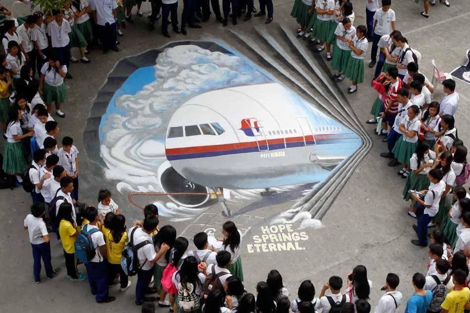 Sympathizing with malaysian victims sidewalk art