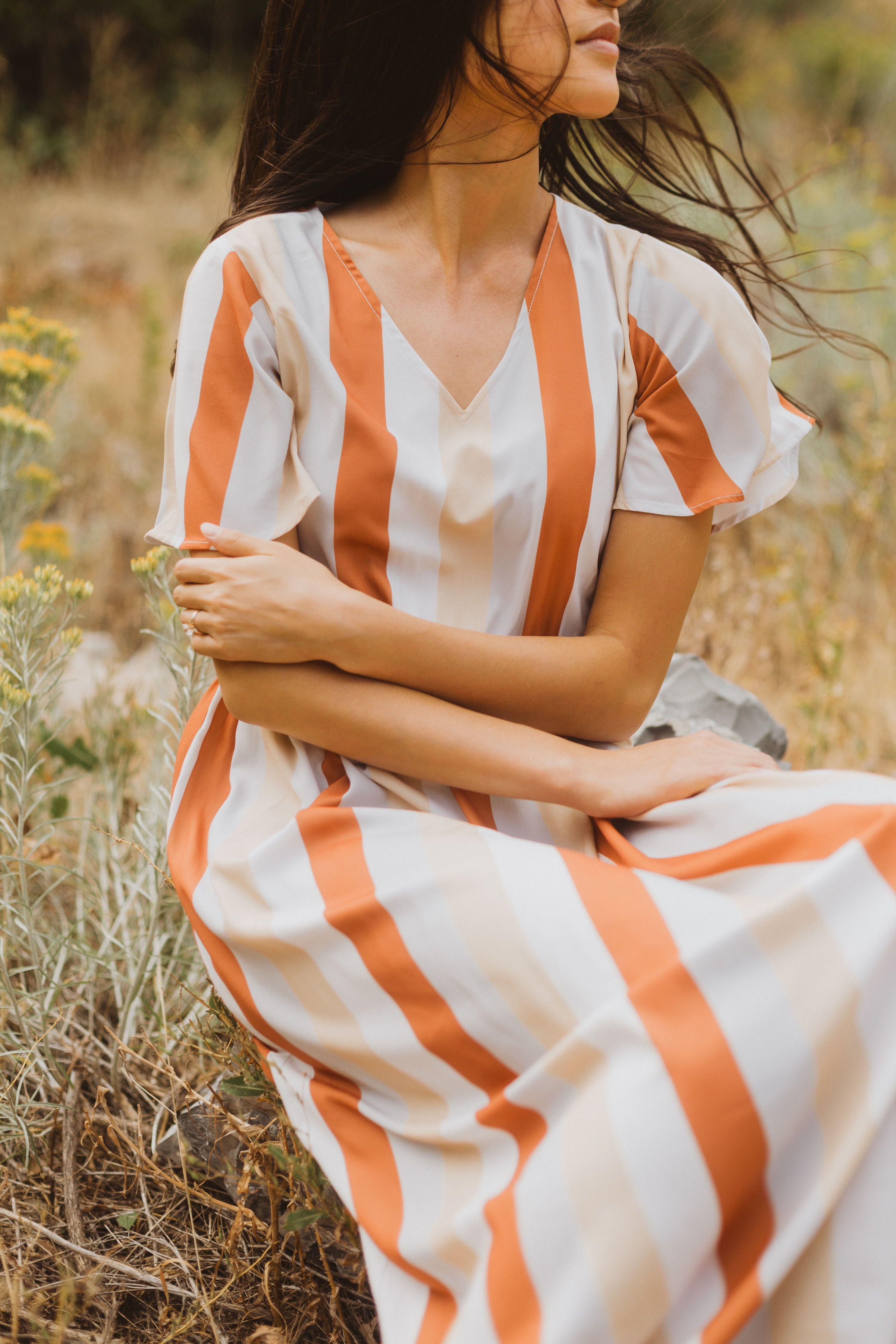 The Butler Striped Maxi Dress Features A Soft V Neckline With Vertical Stripes Down In Pumpkin Pale Peach Agains Striped Maxi Maxi Dress Striped Maxi Dresses [ 4500 x 3000 Pixel ]
