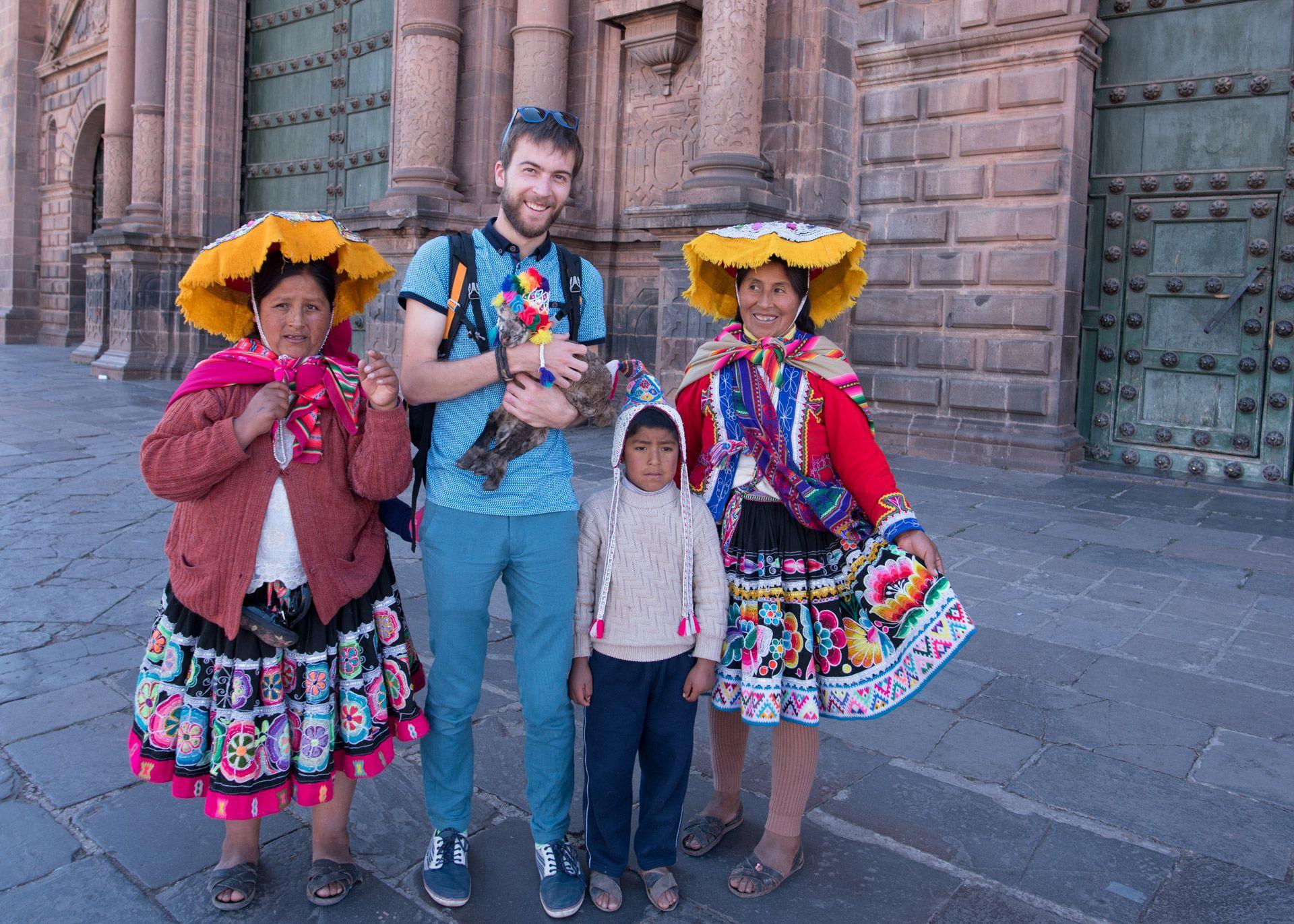 posing with baby alpaca and cholitas in cusco peru