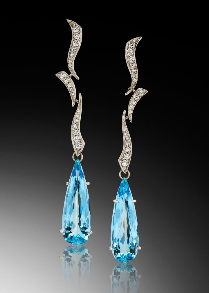 Cascade earrings capture the beauty and purity of water. This unique earring design features two stunning Santa Maria aquamarines set in white gold.