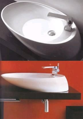 """Here's a very different contemporary vessel sink from Simas - the Simas Bohemien. Sized at 30""""L x 18""""W x 6""""H, this completely asymmetrical vessel sink isn't only of a very interesting overall appearance but the location of the faucet is unusual as well. You can buy this Simas sink for a price of £320 or US$600. The faucet ('siphon') is sold separately."""
