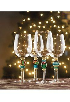 """Festive """"Jeweled"""" Wine Goblets - Set of 4 . $39.95. 10-ounce Glass Wine Goblets. Stem has golden bands and decorations along with multi-colored """"jewels"""". Festive """"Jeweled"""" Wine Goblets - Set of 4. This beautiful, festive set of wine goblets feaures golden bands and designs along with multi-colored """"jewels"""" on the stems.  Set of 4 glass wine goblets  10 ounce  Hand wash  The set is not gift boxed.  This 2009 design has now been discontinued by the  manufacturer."""