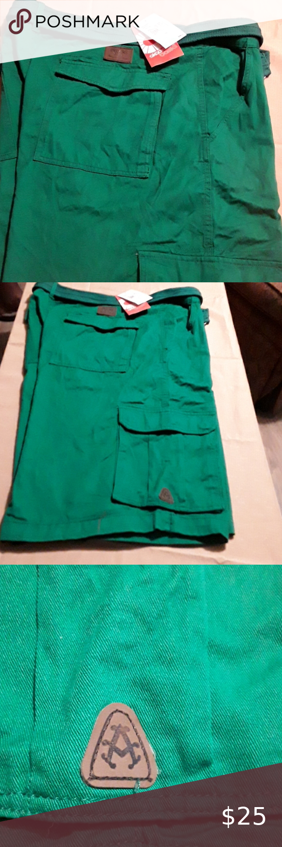 AKADEMIKS GREEN CARGO SHORTS   NWT Cargo shorts have 2 deep pockets in back, 2 deep side pockets and 2 deep front pockets back and side pockets close for added security. Matching belt included. NEVER WORN, STILL HAVE TAGS. Akademiks Shorts Cargo
