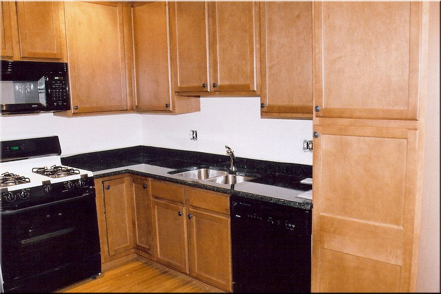 light colored oak cabinets with granite countertop | ... dark ...