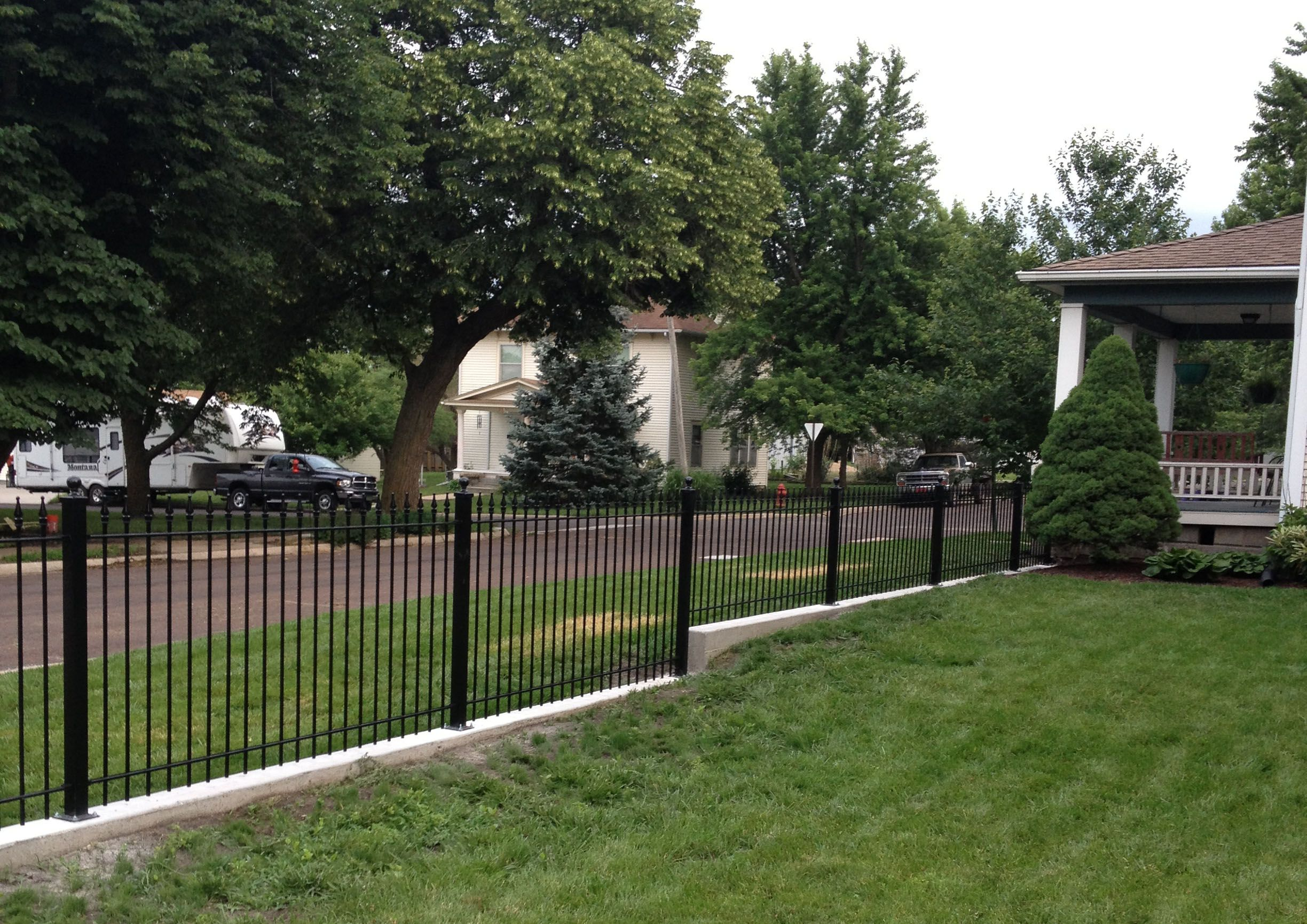 Iron Fence Mounted On Knee Wall And Stepped For Grade Aluminum