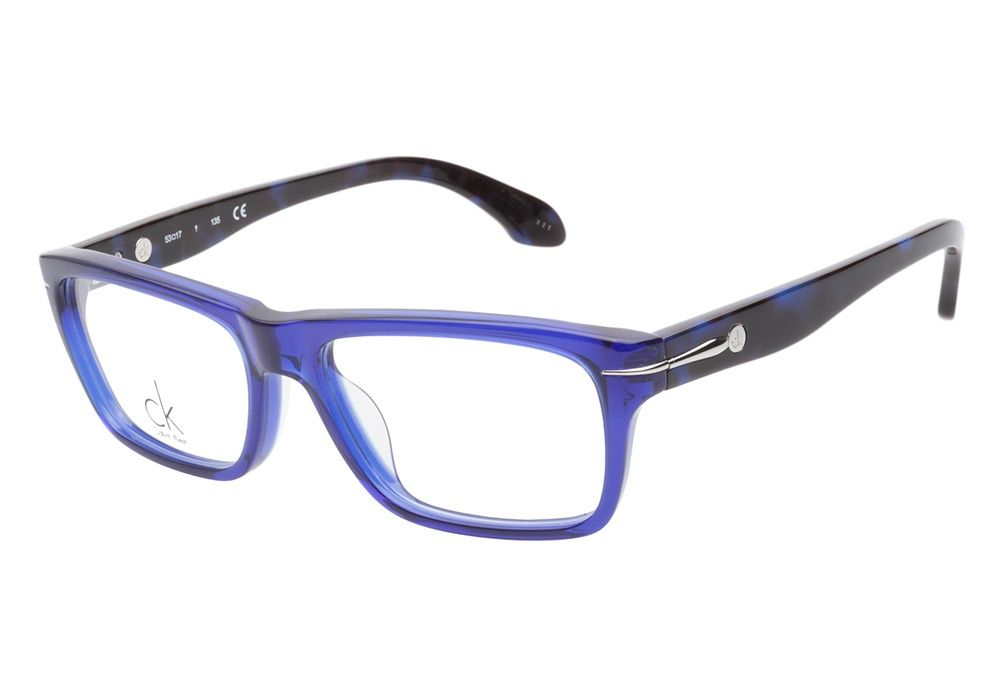 d72ef4f71452 Calvin Klein CK5718 412 Blue eyeglasses are daring and electric. This  vibrant crystal acetate frame has a striking blue hue and distinct  rectangular shape.