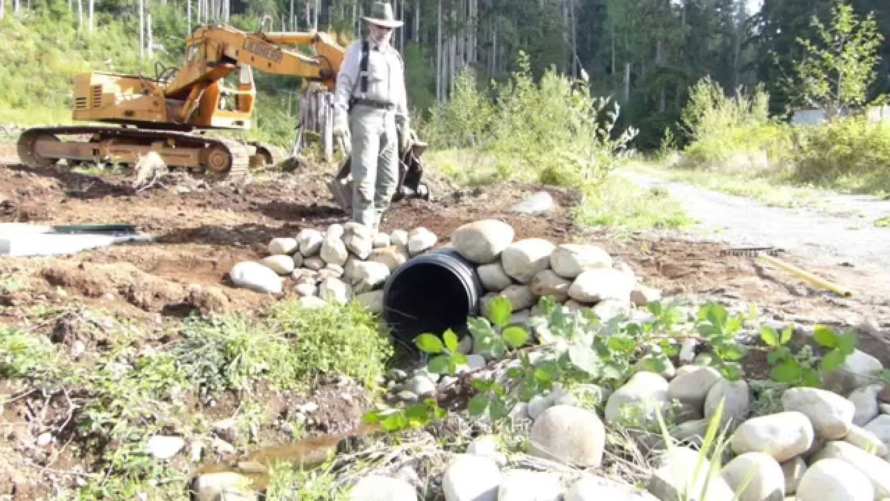 Building A Rock Headwall For Culvert In Three Minutes River Rock Landscaping Landscaping With Rocks Backyard Landscaping