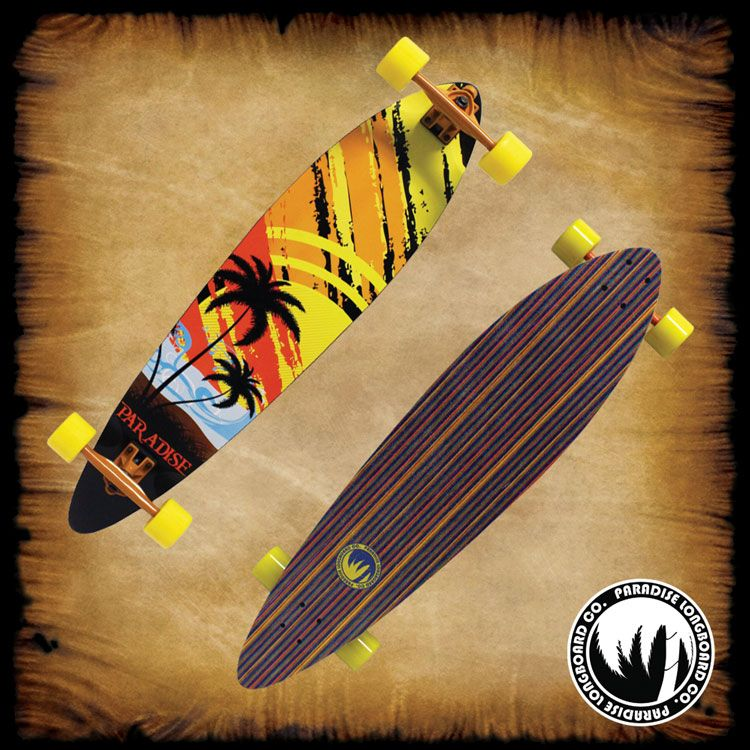 """PARADISE LONGBOARDS """"Sunset Sketch"""" PALB-62TIN Pintail. 7 ply's of Canadian maple, deck measures 9.75"""" x 40"""" and a top inlay. This is one of the easiest longboards to maintain stability and stay in control. The Bigfoot Boho wheels are 70mm with a 80a hardness and 44mm wide footprint that make the wheels perfect for smooth as silk riding without sacrificing speed. The board is complete with high-grade, 181mm downhill aluminum alloy trucks, Abec-7 Speed Bearings, Hardware, & Risers."""