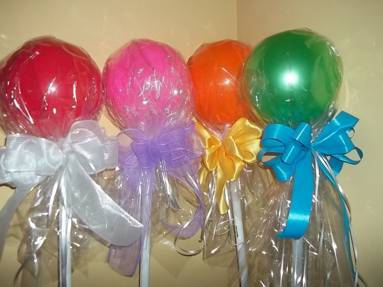 Lollipops, small balls from walmart, pvc pipe, cellophane