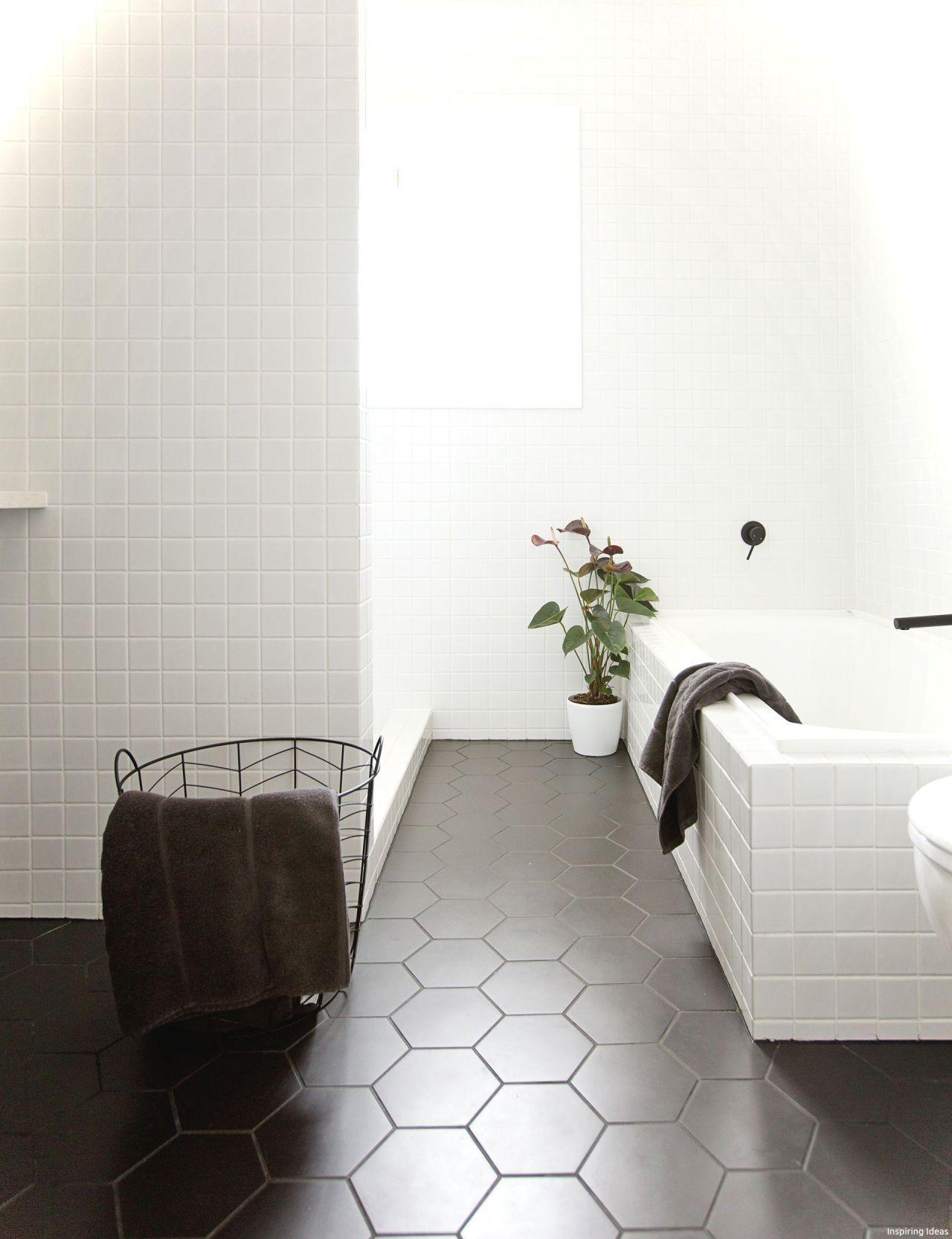 Black & White Bathroom With Black Tiles And White Tub