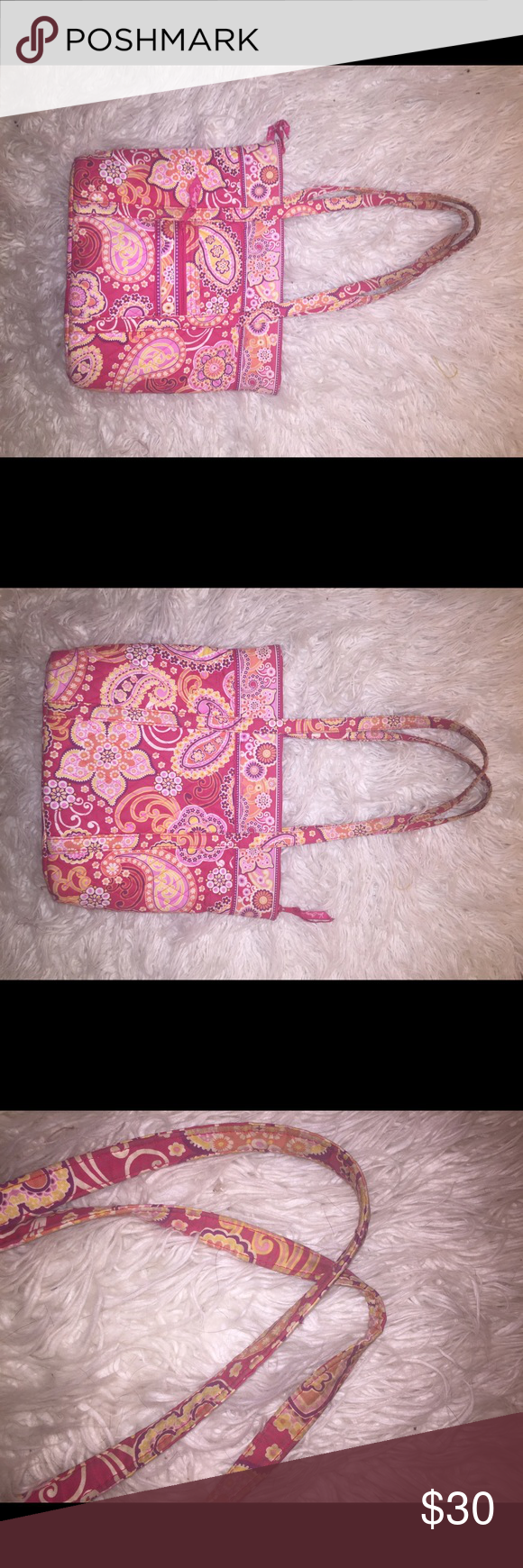 Vera Bradley tote bag Bag is in very good used condition. The straps at the top are slightly faded from use, they may look better after being washed! There is also one mark in the bottom (see pics of flaws). Make offers! Vera Bradley Bags Totes