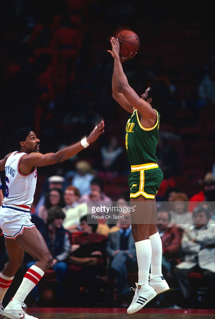 Adrian Dantley  4 of the Utah Jazz shoots over Julius Erving  6 of the  Philadelphia 76ers during an NBA basketball game circa 1984 at The Spectrum  in ... 90c288be7
