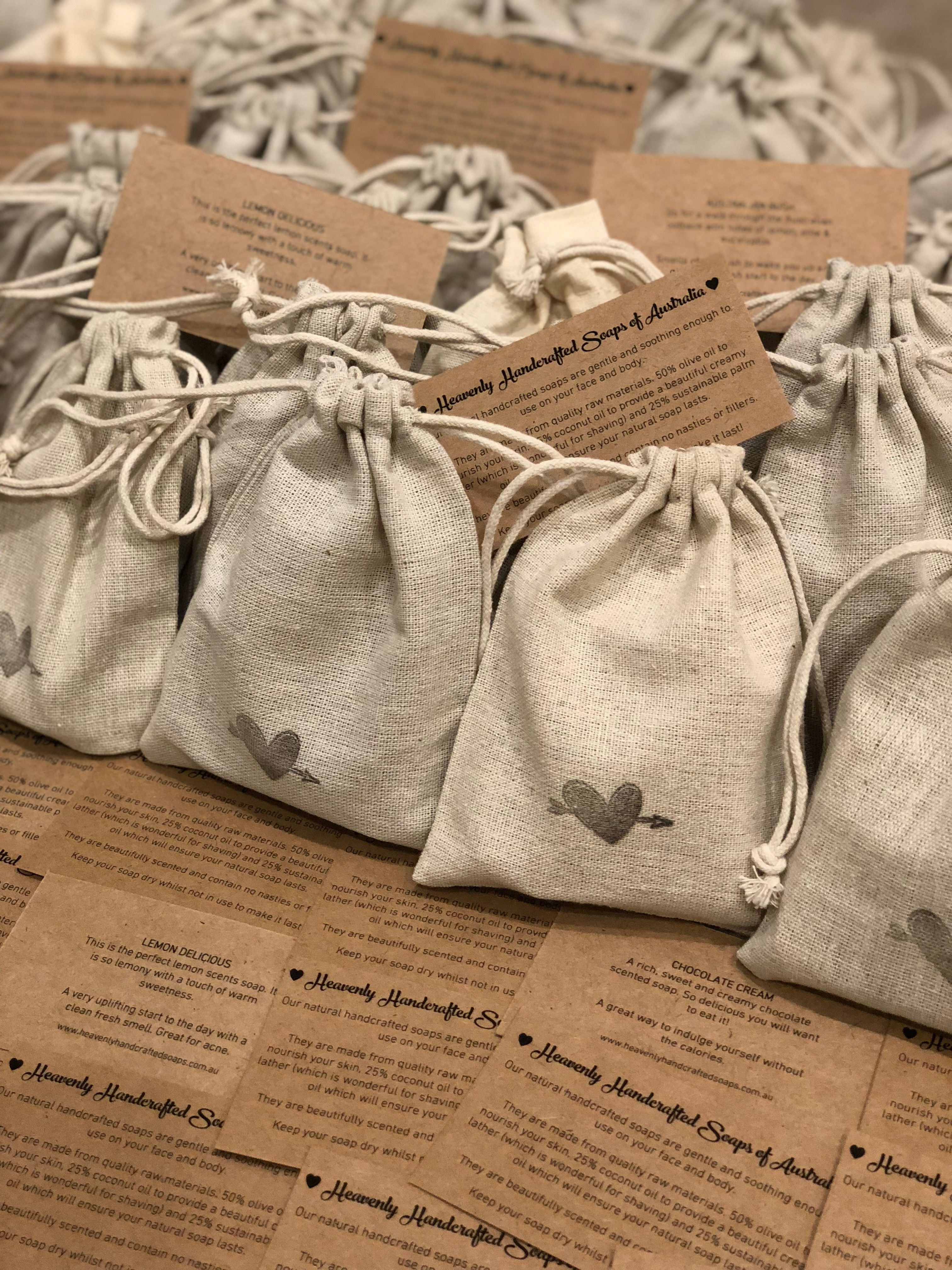 Soaps custom packaged in a small jute bag hand stamped