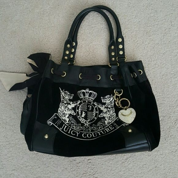 Juicy couture dream catcher tote Authentic. Great condition! Only reason I'm selling is because I just purchased a new bag and I don't really use tote bags anymore. Please ask questions prior to purchase. Bundle to save! Juicy Couture Bags Totes