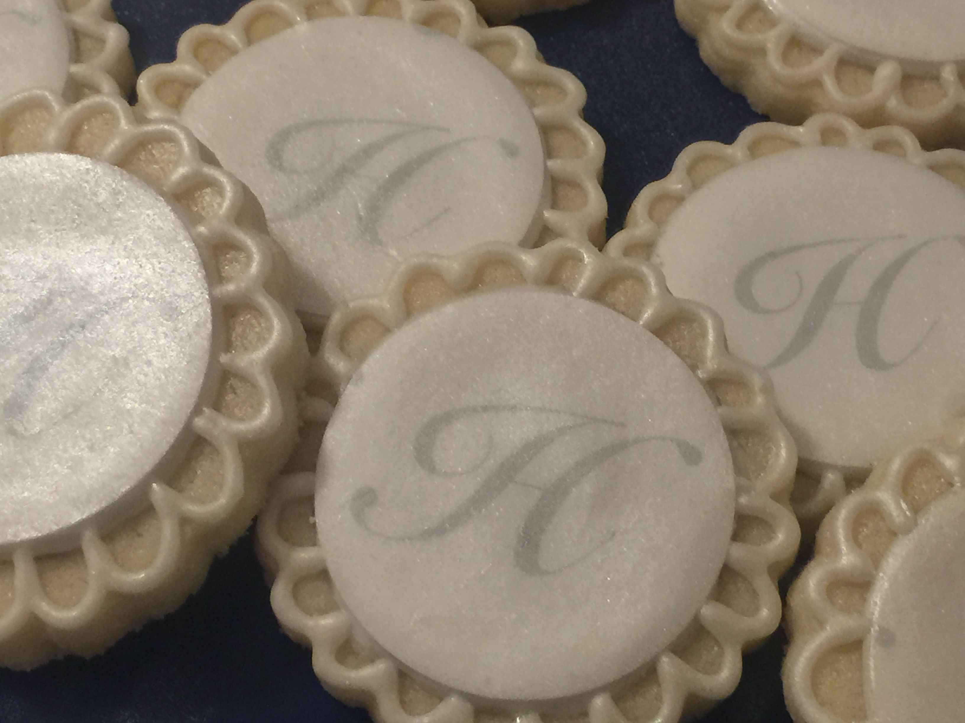 Couples wedding shower cookies with a pearl finish. Monogram printed on wafer paper. #edibleimages