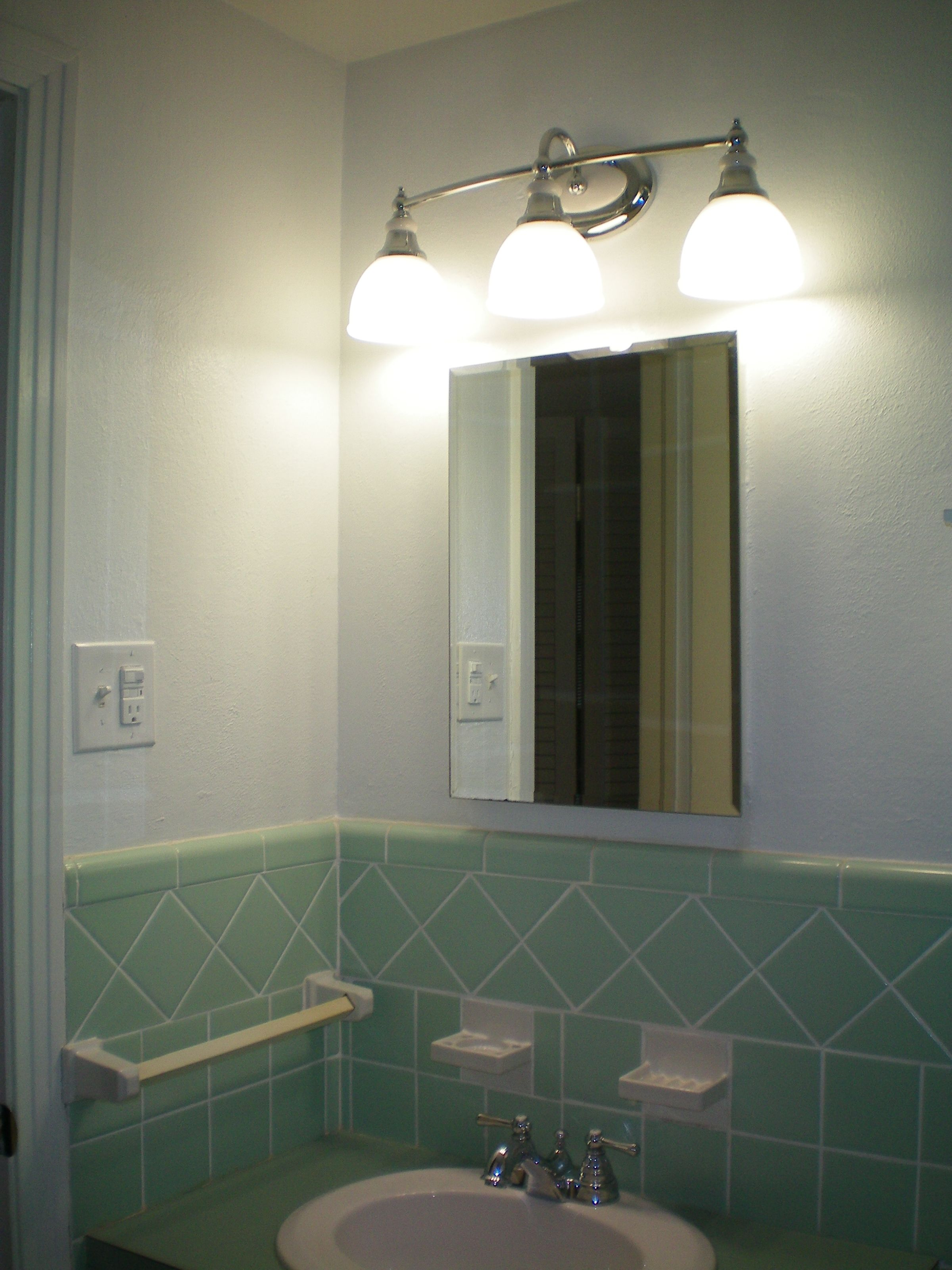 New light fixture and outlets to update our 1950s bathroom
