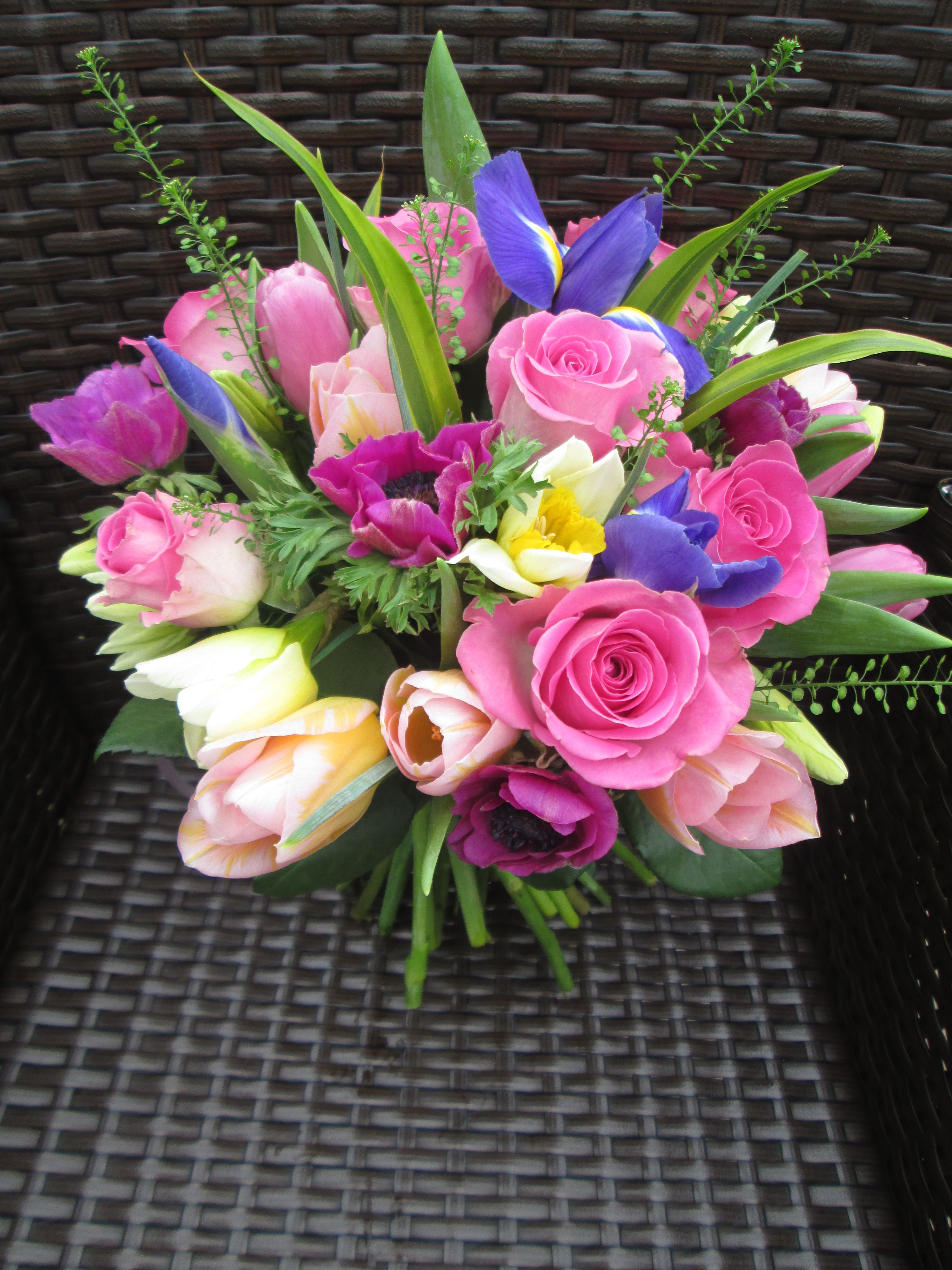 Spring bouquet of iris, aqua pink rose, daffodil, anemone, tulip and ...