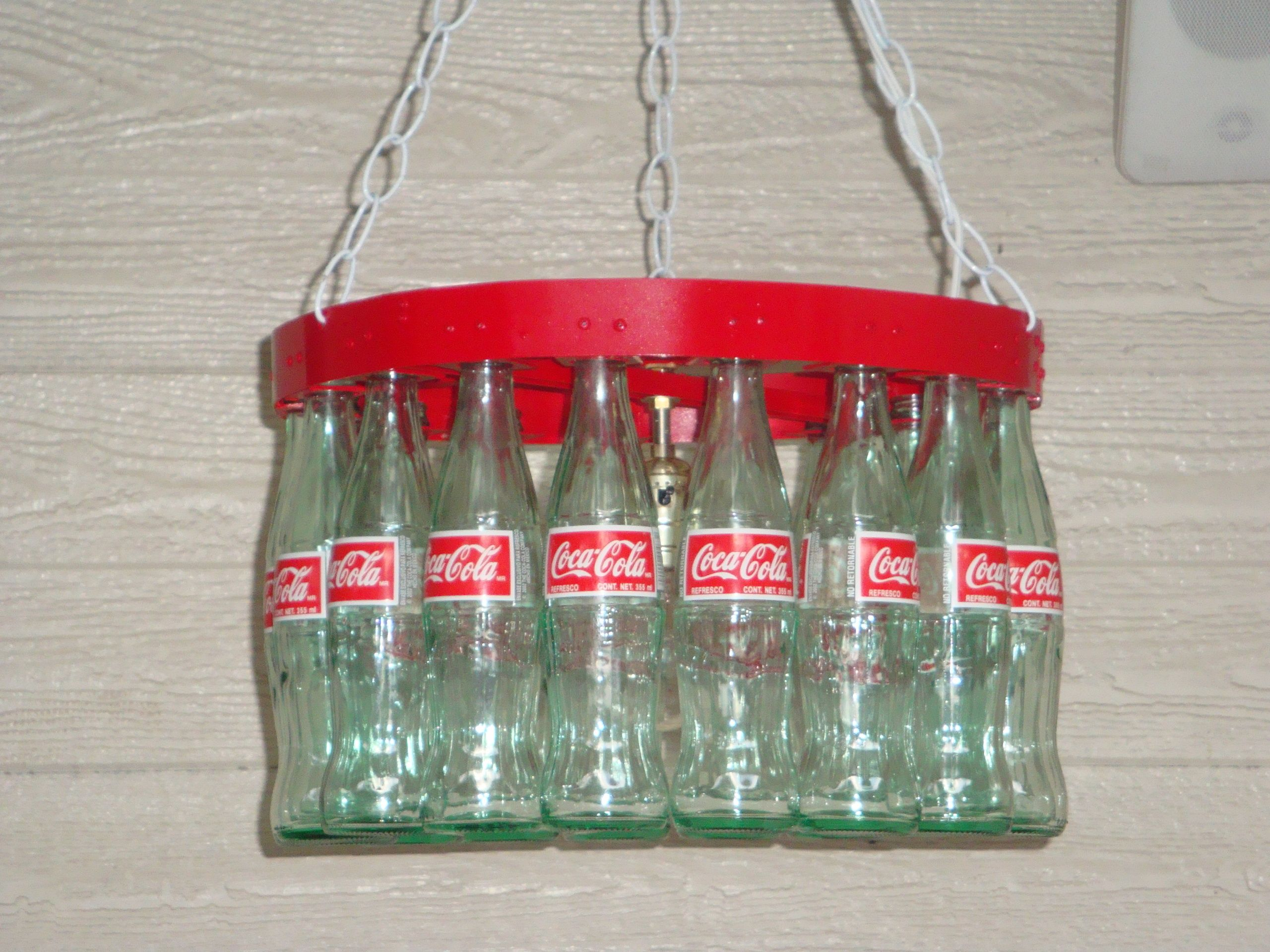 Coca cola bottle chandelier such an interesting way to recycle coca cola bottle chandelier such an interesting way to recycle old coke bottles funky room design pinterest bottle chandelier coca cola bottles arubaitofo Images