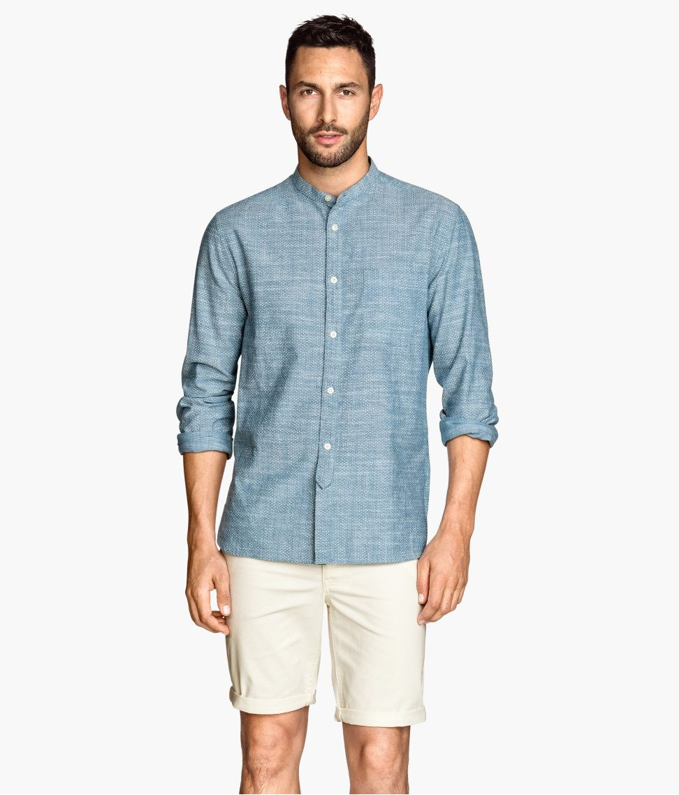 This chambray button-down shirt & pair of white 5-pocket shorts ...
