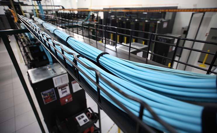 A view of the overhead cabling trays in a Rackspace data center ...