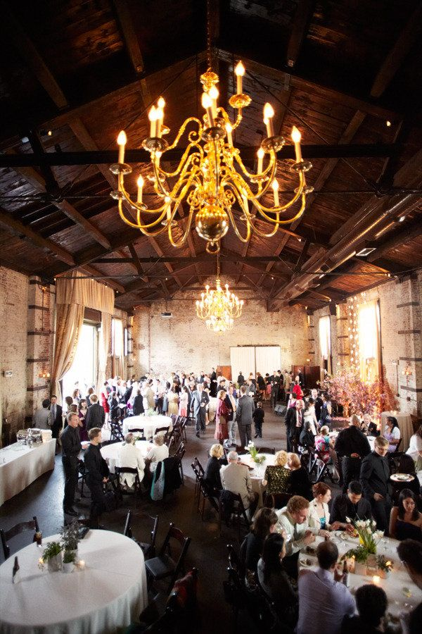 Stylish Green Building Wedding Ruffled Wedding Ceremony Backdrop Indoor Indoor Wedding Ceremonies Industrial Wedding