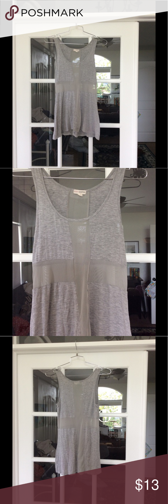 "Edgy, Cool Tank from Zenana Outfitters This is a killer tank from Zenana Outfitters. Gray rayon and spandex with a mesh ""cross"" in front and back. Size S but could easily fit a medium. Zenana Outfitters Tops Tank Tops"