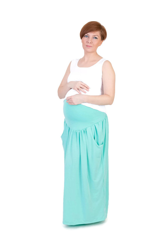This is a handmade pregnancy skirt. Its got a very stretchy panel which expands as your belly grows It will add a more feminine look to your