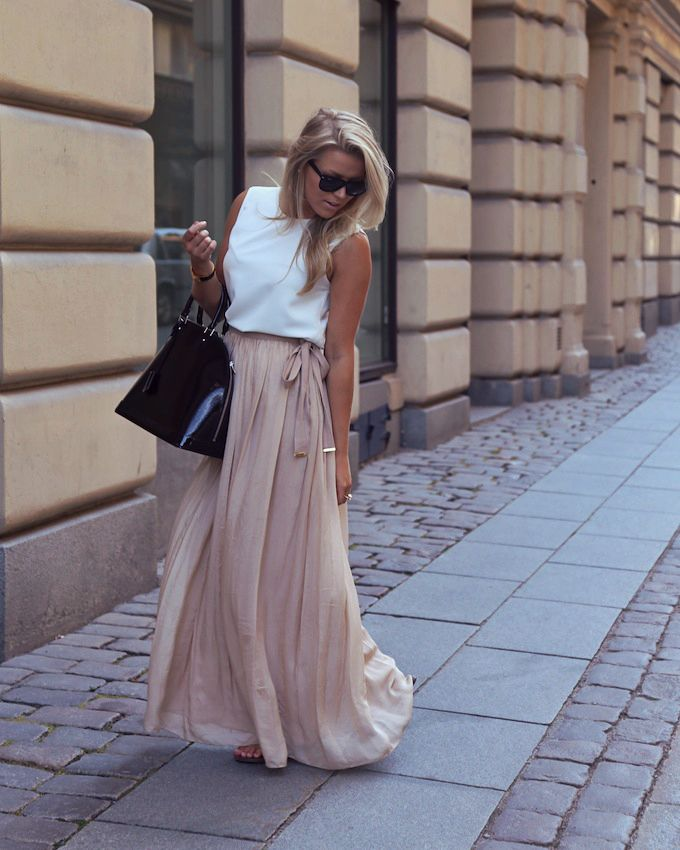 Everything here mathes , hair hair , her skin tone , the cream skirt with a white top! Love it.