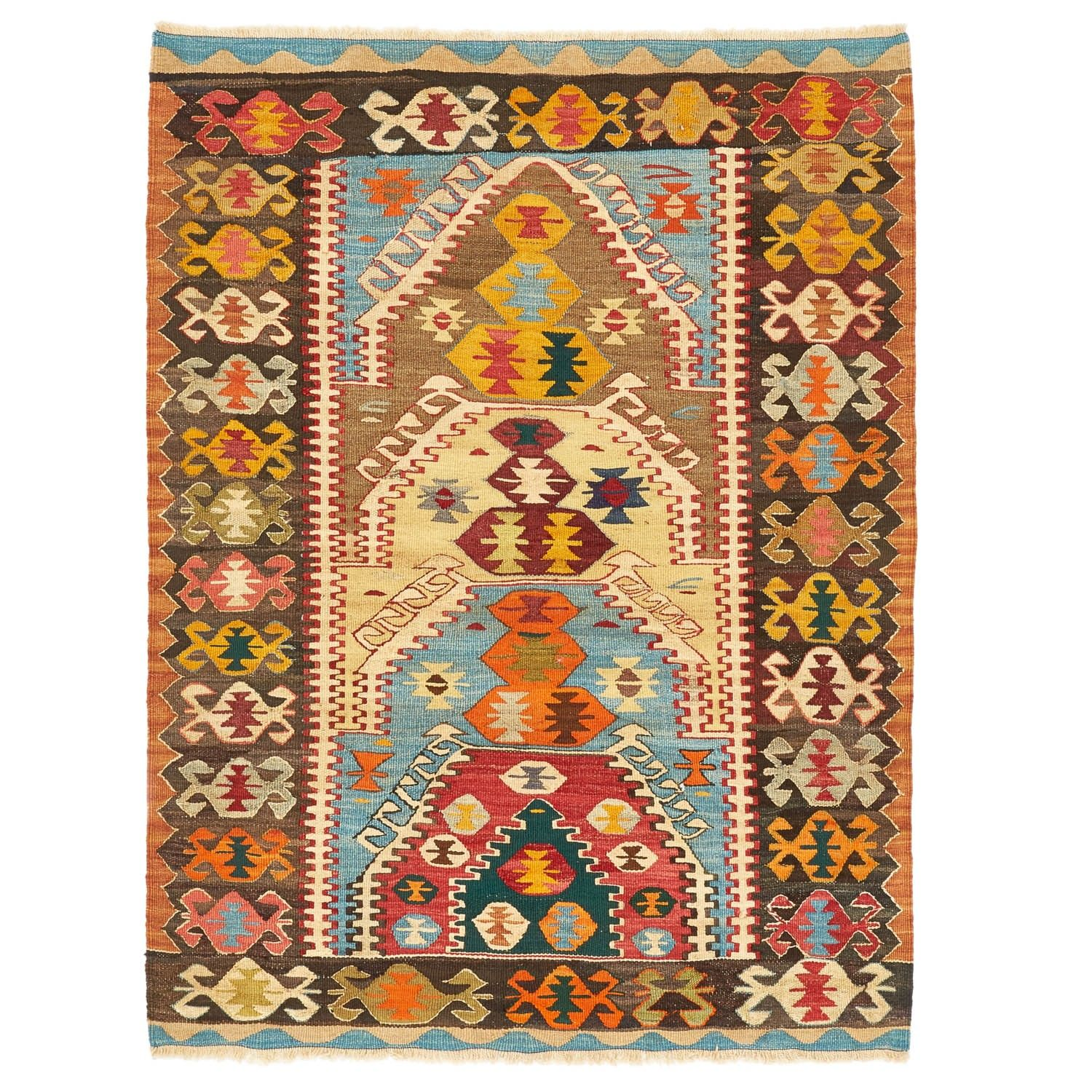 A series of nested designs creates a compelling focal point on this wool kilim, handwoven in Turkey. Crab motifs, traditional symbols found in Caucasian weaving, form a frame within the crenellated border. Culled from around the world, the carefully curated flat weave and kilim collection embodies distinctive symbolism of cultures past and present.